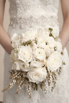 Moss Industry Weddings Nikole Ramsay Photography, bouquet of white roses, ranunculus and pieris japonica