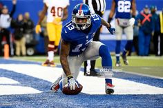 Odell Beckham Jr. #13 of the New York Giants celebrates after scoring a 6 yard touchdown in the fourth quarter against the Washington Redskins during their game at MetLife Stadium on December 14, 2014 in East Rutherford, New Jersey.