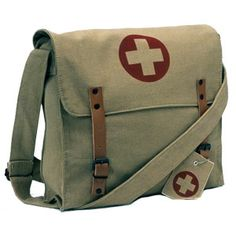 Rothco 9121 Vintage Khaki Army Medic Messenger Bag with Medic Cross Emblem. Made of stonewashed cotton canvas. Large main compartment with flaps and brown leather closing straps with medal buckle closure. Army Medic, Combat Medic, Laura Harrier, Fallout 3, Fallout New Vegas, Fallout Vault, Nurse Bag, Medical Bag, Medical Field