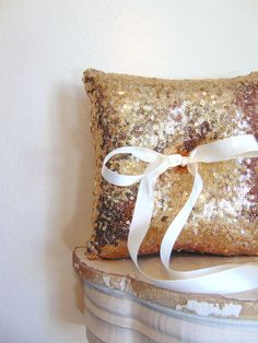 This ring bearer pillow is a perfect touch to your wedding. A soft satin ribbon is sewn in and ready for you to tie on your wedding rings. The underside of the pillow is the same fabric. This sequin fabric is a mesh fabric. The mesh fabric is overlaid another solid fabric that may show through a little bit. The under layer fabric is gold. Measurement: 9 inches x 9 inches  Small enough for little hands to carry!  To see more ring bearer pillows click on the following link:  https://w...