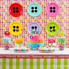 "Your Lalaloopsy party dessert table will look fab with a wall of paper plate ""buttons"" behind it! Just add black paper ""button holes"" to your fave colorful paper plates. Click for more fun party DIYs!"