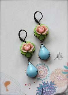 I love these earrings with the tiny pink roses.  I love vintage jewelry.  Just might have to buy for myself.