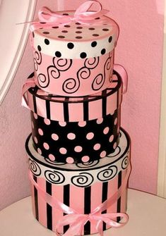 Pink and black printed hat boxes would be great for centerpieces and you could use them for bachelorette party gifts too!