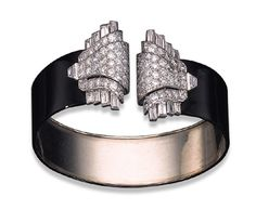 AN ART DECO DIAMOND AND LACQUER BANGLE, BY CARTIER   The front set with two circular and baguette-cut diamond pyramidal detachable clip by madge