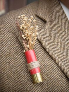 Show off one of your favorite pastimes with a shotgun shell boutonniere. Courtesy of The Sass Shoppe