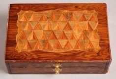 A veneered writing box on a stand