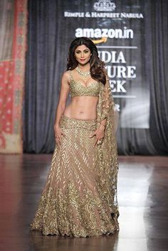 Shilpa Shetty look super glamorous in when she walked down the ramp recently... Comment below if you don't just love her lehenga!