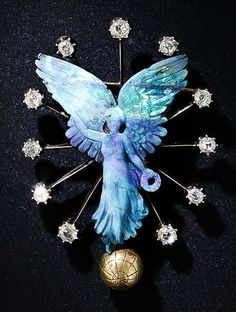 Carved Opal and Diamond 'Nike' Brooch