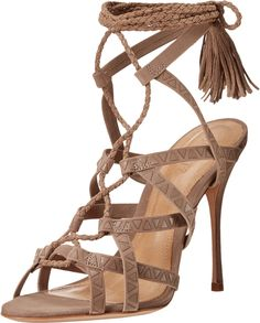 Schutz Women's Lydia Goat Sandal. Liven any ensemble with the vivacious Lydia heels from Schutz®!. Suede upper. Braided, wrap-around ankle strap with tasseled tie closure. Open toe, strappy silhouette with geometric design. Lightly padded leather insole. Wrapped stiletto heel. Leather sole. Made in Brazil. Measurements: Heel Height: 4 1⁄2 in Weight: 8 oz Platform Height: 1⁄4 in Product measurements were taken using size 8, width M. Please note that measurements may vary by size.