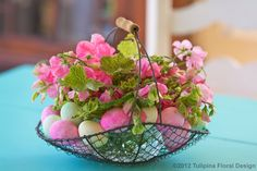 Pastel Sweet Peas and eggs inside French wire basket for Easter holiday.  http://facebook.com/tulipinadesign
