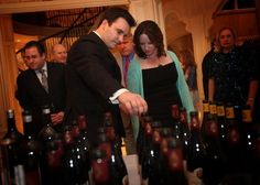Jean-Baptiste Cristini, director of export for Champagne Delamotte, reviews some of the wines with V at the Elkins home for the 2010 Naples Winter Wine Festival.