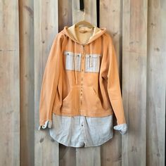 Item Overview: • Handmade Item • Materials: recycled clothing, upcycled clothing, cotton, heavy cotton sweatshirt, repurposed shirts. • Ships worldwide from St. Paul, Minnesota Item Details: This funky hoodie sweatshirt is comfy and casual. A refashioned sweatshirt tunic in orange weathered cotton with color coordinated plaids makes for the perfect weekend wear. This flattering sweatshirt would look perfect with jeans or leggings on a chilly day --- you can see yourself kicking up the fall…