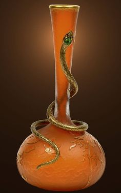 An Art Nouveau etched and gilded glass vase with an applied gilt metal serpent inset with glass stones, Daum, France circa 1900.