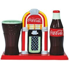 'Colorful' is what you'd call these ceramic salt and pepper shakers + toothpick holder which appear in the form of a Coke glass, a Coke bottle, and a jukebox.