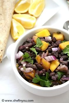 Mexican styled Black Beans with Mango: delicious and super easy to put together. Don't forget the jalapeño, gives it that kick!