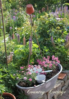 love the little flower pot on top of the canes .... stop me poking my eyes out! country garden