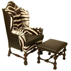 Early 20th Century zebraskin covered wing chair and ottoman in William & Mary Revival style.