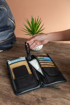 The bucket list traveler wallet is here to help with its various pockets and storage to organize your out of the house or travel essentials. #veganleather #vegan #fashion #handmade #sustainablefashion #fauxleather#travelessentials #traveldiary #travelmore #travelinspiration #travel #traveling #travelwithme #travelbug #travelinbetween #beautifuldestinations #traveler #travelblogger #travelling #travelobsessed #travelpic #seekmoments #workandtravel #travelholic #travelanddestinations