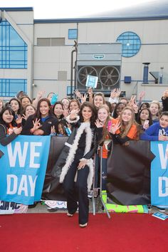 """Selena Gomez posing for a photo with fans while attending """"We Day Illinois"""" at the Allstate Arena in Rosemont, Illinois. April 2015, 2015."""