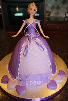 Rapunzel Doll Cake - Rapunzel cake for my niece turning 6. Hearts are are to hold the candles. Chocolate cake covered in fondant. BC trim on the dress. Thanks to many others on CC for the wonderful ideas.