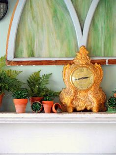 Stained Glass, French Clock, aged terracotta pots, greenery--perfect Spring Mantel