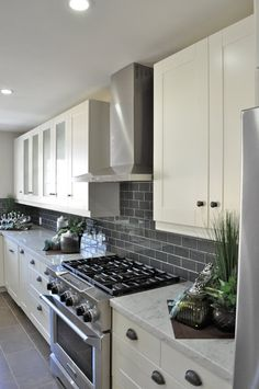 I love the dark gray back splash.  I don't want white cabinets but a lighter or mid tone gray cabinet with a mid or lighter tone gray wall might work.