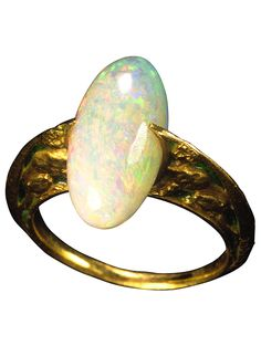 Opal Sphynx Ring by René Lalique, circa 1900. The shoulders decorated with green enamel expanding to grip the opal bezel, secured by claws at the front and back. #Lalique #ArtNouveau #ring