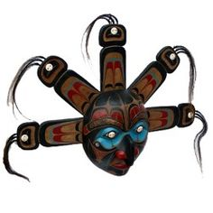 """Hand Carved Wooden Native American Sun Mask From the site """"This large 'sun' mask is as striking piece with great features. There are copper eyebrows and bone inlays in the eyes as well as cured horse hair. Price: £299.00 Shipping: £7.99""""   Crazy."""