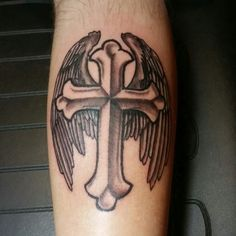 Cross with wings.