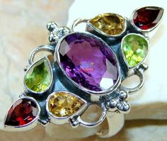 Beautiful item with Amethyst Faceted, Peridot Faceted, Garnet Faceted, Citrine Faceted Gemstone(s) set in pure 925 sterling silver.