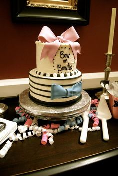 Bows or bowties gender reveal... Cake ... Pink and blue