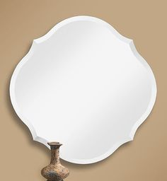 362 – Unique frameless mirror with 1″ beveled edge. Ideal for a bathroom vanity or foyer yet still functional for any room in your home.30″ wide, 30″ high and 3/8″ dee…