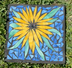 """12"""" garden stepping stone with stained glass top...don't know how practical this would be...glass gets awfully slick when wet and the Annie Lenox's song """"Walking on Broken Glass"""" makes me sad. While this would be excellent practice for making my own kitchen countertops from concrete and glass, I might have to find another use for the practice pieces."""