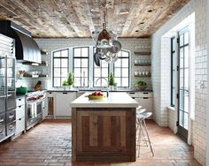 Love this rustic kitchen with reclaimed wood ceiling, subway tile walls, brick floors...great arched windows too. Very nice! Don't ya think?!