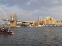 Brooklyn Bridge and the Watchtower Building from South Street Ferry Pier by Raphael Bick, via Flickr