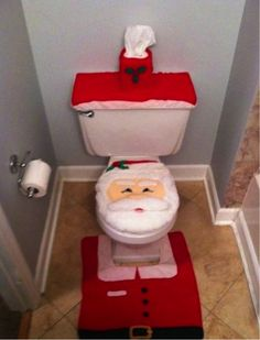 REALLY bad decorating ideas - Poor Santa - This would of course keep the bathroom clean, no one would want to use it. :)