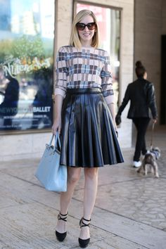 New York Fashion Week Street Style black pleated leather skirt and ankle strap heels