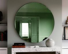 """Green Deco mirror. 30"""" diameter round Art Deco Inspired green Wall Mirror. 1920s and 30s inspired furniture."""
