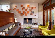 Split level living room with orange canvas art display in Odyssey House, Carmel, California, USA. Stock Photo