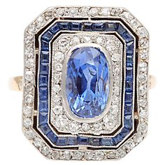 Sapphire Diamond Cluster Ring | From a unique collection of vintage cluster rings at http://www.1stdibs.com/jewelry/rings/cluster-rings/
