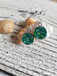 Green druzy pendant charm earrings silver plated // sparkly druzy dangle earrings // druzy jewelry // druzy lover gifts Green sparkly druzy pendant charm earrings. Silver plated hook and soft plastic backing.