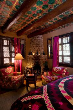 Bedroom at Inn of the Five Graces in Santa Fe. Colorful Southwestern decor.