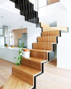 The sculptural bamboo stair at this Madrid dwelling by Marta Badiola + Jorge Pizarro functions as a decorative and interactive spatial link between different rooms and is sustained with tensioned steel wires. : courtesy of the designers. #architecture #interiors #design #interiordesign #staircase #madrid @martabadiola... - Interior Design Ideas, Interior Decor and Designs, Home Design Inspiration, Room Design Ideas, Interior Decorating, Furniture And Accessories