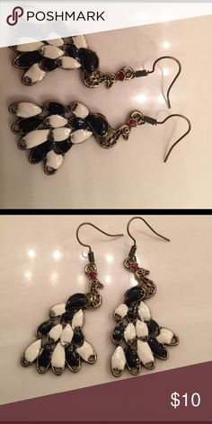 Ladies black and white peacock earrings A pair of dangling black and white and bronze peacock earring good condition Jewelry Earrings