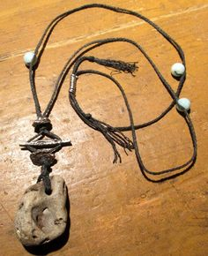 Natural Holey Stone Amulet Necklace with Blue Larimar Beads   Free Shipping. $75.00, via Etsy.