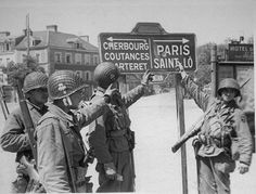 Four paratroopers of the Airborne Division at a road sign in the town of Carentan, 1944 D Day Normandy, Cherbourg, 101st Airborne Division, Army Infantry, Bagdad, Band Of Brothers, Paratrooper, American Soldiers, Military History