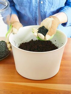 Mix It Up - Combine remaining charcoal with soil either by hand or with trowel.