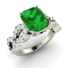 Emerald-Cut Emerald  and Diamond  Sidestone Ring in 14k White Gold
