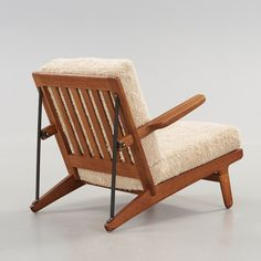 Børge Mogensen; Oak and Iron Easy Chair for Fredericia, 1950s.