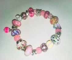 Pink euro (pandora) stretch bracelet that sure to dazzle! by tonispretties on…